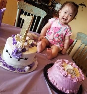 A 1-year old girl on her birthday.