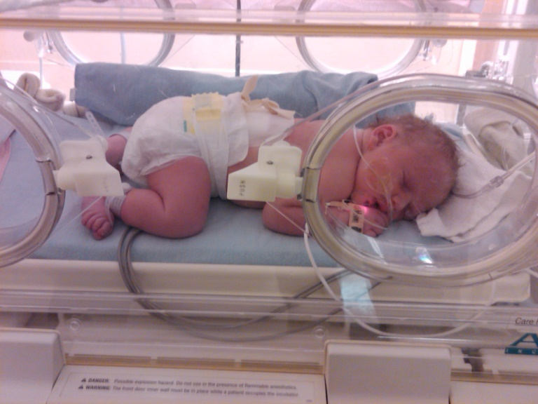 Nickolas as a baby in an incubator.