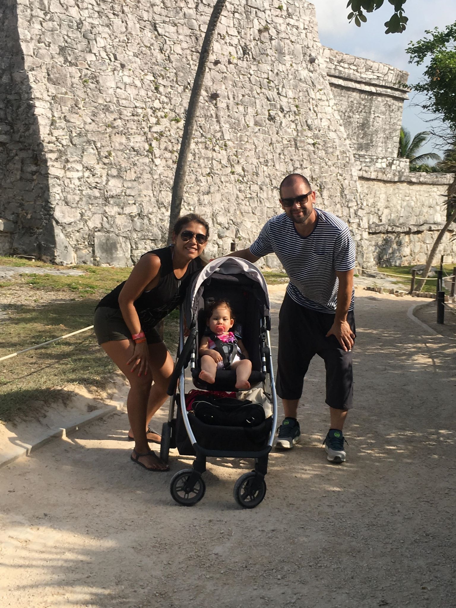 The Cano Family on vacation, in front of a landmark.