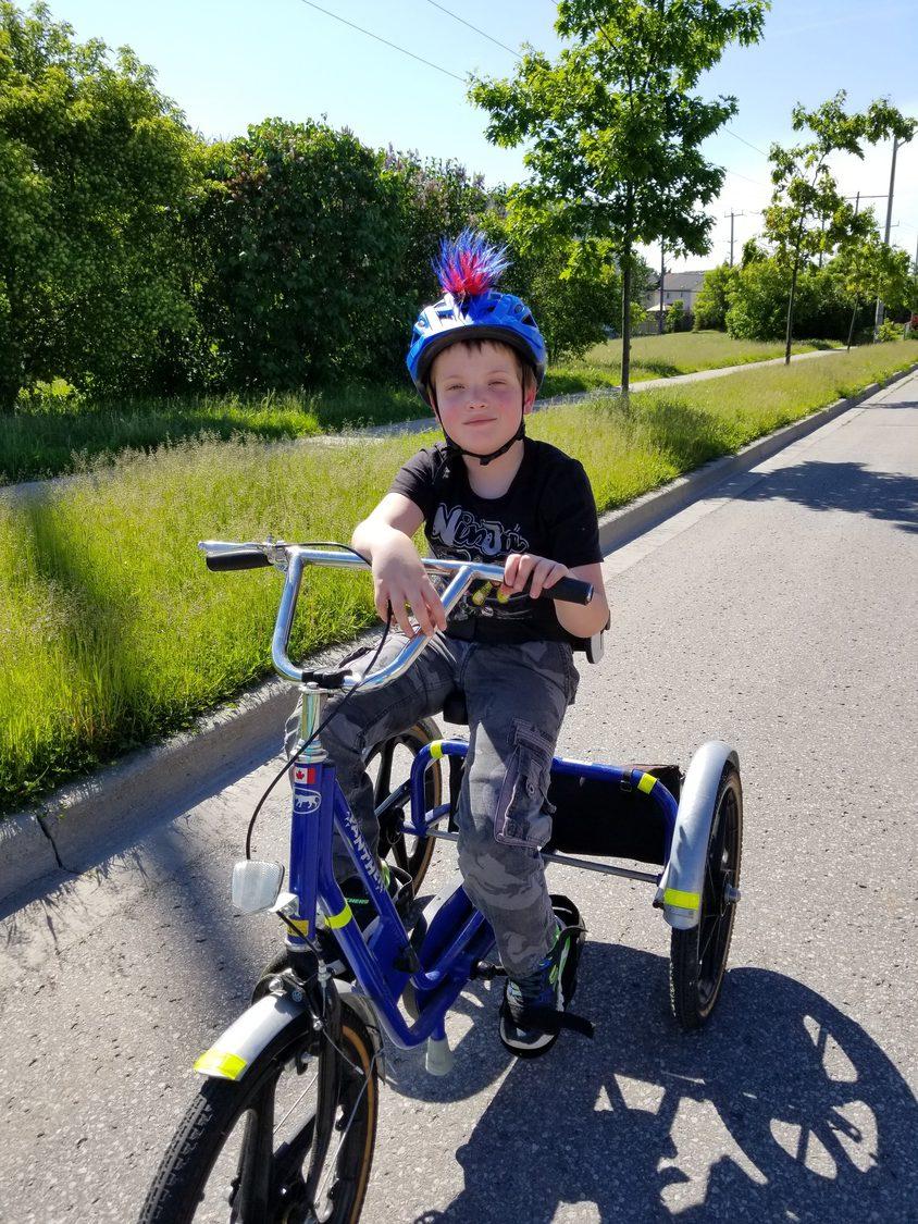 Nickolas riding his bike.